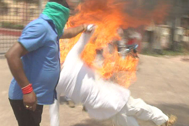 PDS scam: Congress workers burn effigies of CM, PM; clash with police